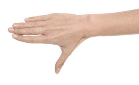 Woman showing pale hand on white background, closeup. Anemia symptom