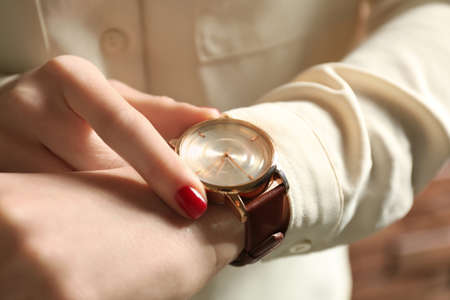 Woman wearing luxury wristwatch, closeup of hand Stock Photo