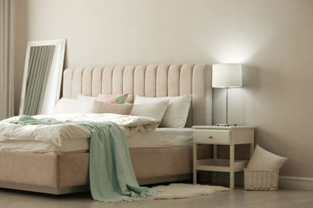 Stylish room interior with large comfortable bed Archivio Fotografico