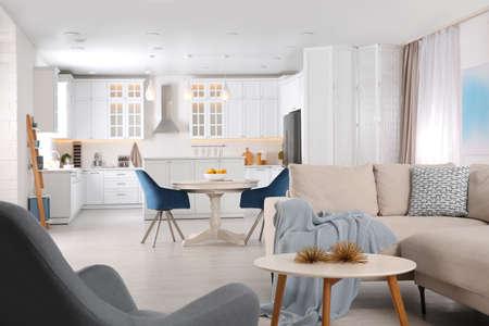 Stylish studio apartment interior with comfortable beige sofa Stockfoto