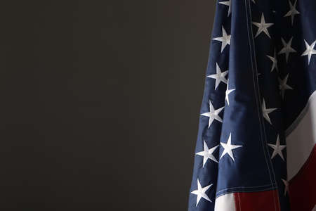 America flag on grey background, closeup with space for text. Memorial Day Foto de archivo