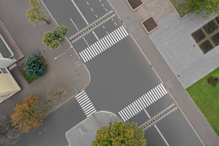 Aerial view of white pedestrian crossings on city street Banque d'images