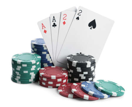 Playing cards and plastic casino chips on white background. Poker game
