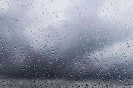 Water drops on window glass, closeup. Rainy weather