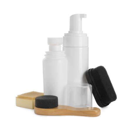 Set of shoe care products on white background