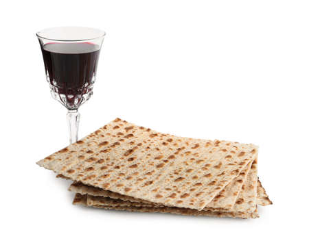 Traditional matzos and red wine on white background
