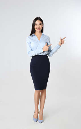 Full length portrait of young businesswoman on white background