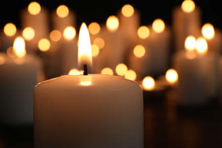 Burning candle in darkness, closeup. Memory day Archivio Fotografico