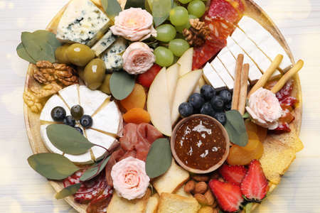 Assorted appetizers on white wooden table, top view