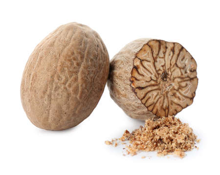 Grated nutmeg and seeds isolated on white Stock Photo