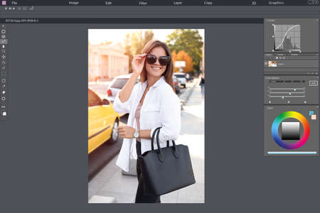 Professional photo editor application. Image of young woman in sunglasses with stylish black bag