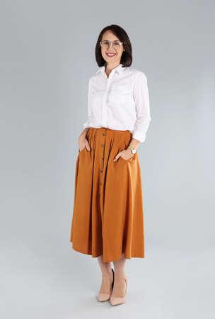 Full length portrait of mature businesswoman on light grey background Stock Photo