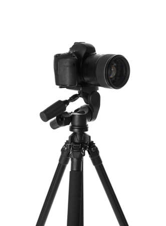 Modern tripod with camera isolated on white Imagens
