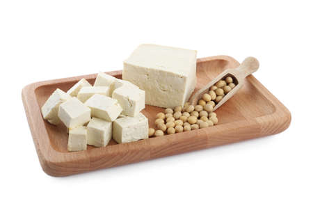 Pieces of delicious tofu and soy on white background