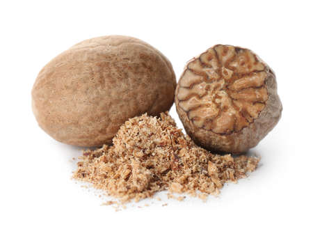 Grated nutmeg and seeds isolated on white