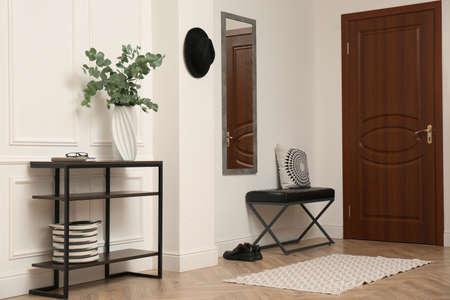 Light hallway with stylish furniture. Interior design