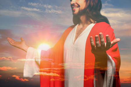 Jesus Christ reaching out his hands and praying at sunset, double exposure