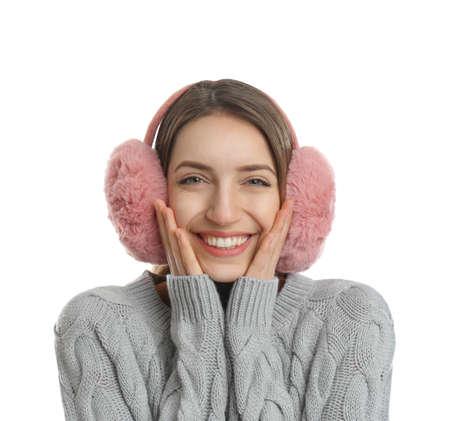 Happy woman wearing warm earmuffs on white background Reklamní fotografie