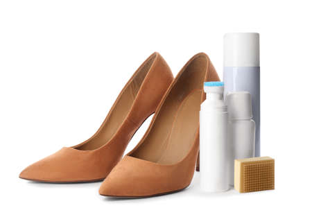 Stylish footwear with shoe care accessories on white background