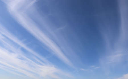 Beautiful fluffy white clouds in blue sky