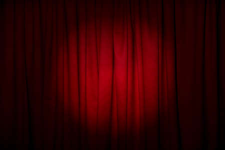 Closed elegant red front curtains as background