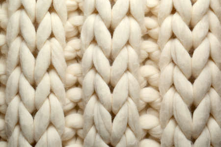 White knitted wool texture as background, top view Stock Photo