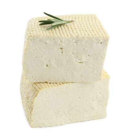 Pieces of delicious tofu and rosemary on white background. Soybean curd