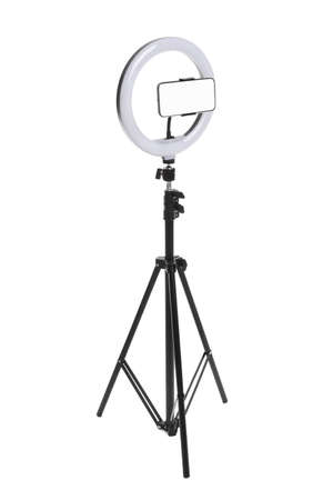 Modern tripod with ring light and smartphone isolated on white