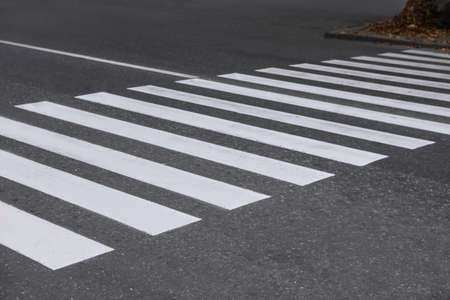 White pedestrian crossing on empty city street