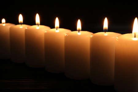 Burning candles on dark background. Memory day Archivio Fotografico