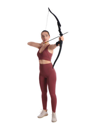 Woman with bow and arrow practicing archery on white background