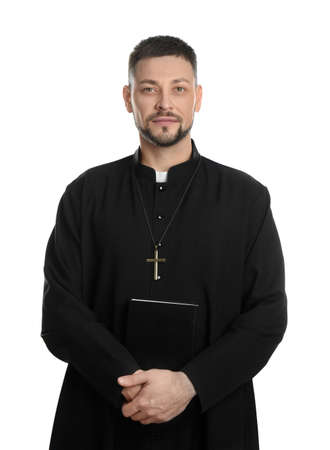 Priest with Bible and cross on white background
