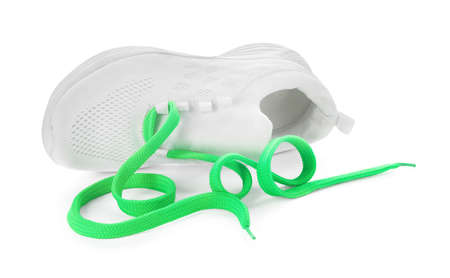 Stylish sneaker with light green shoelaces on white background