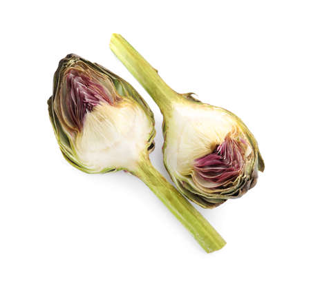 Pieces of fresh raw artichoke on white background, top view