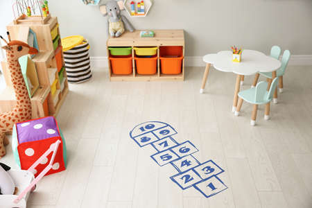 Blue hopscotch floor sticker in playing room