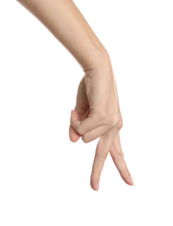 Woman imitating walk with hand on white background, closeup. Finger gesture