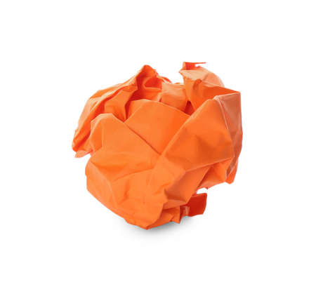 Crumpled sheet of orange paper isolated on white