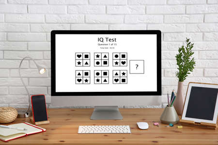 Modern computer with IQ test on screen in office