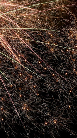 Beautiful bright fireworks lighting up night sky Banque d'images