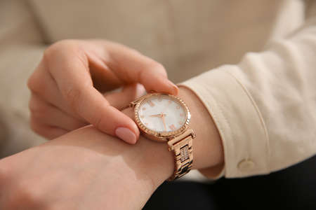 Woman in casual shirt with luxury wristwatch, closeup Stock Photo