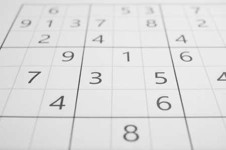 Sudoku puzzle grid as background, closeup view