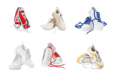 Set of different stylish shoes with laces on white background