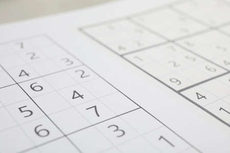 Sudoku puzzle grids on table, closeup view