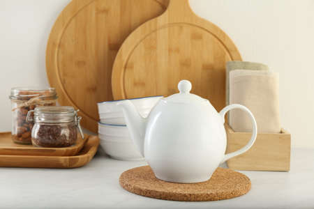 Modern kitchenware and products on white marble table