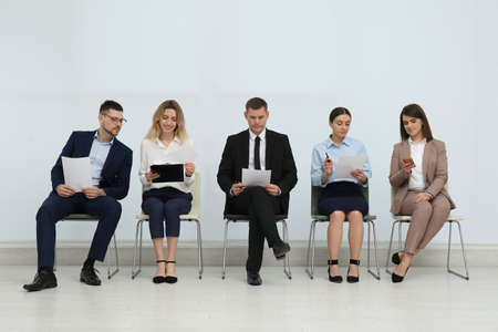 People waiting for job interview in office hall