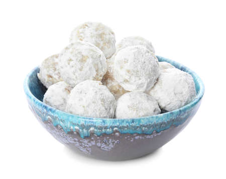 Tasty snowball cookies in bowl isolated on white. Christmas treat