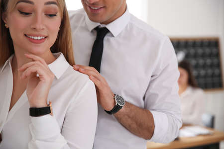 Man flirting with his colleague during work in office, closeup Foto de archivo