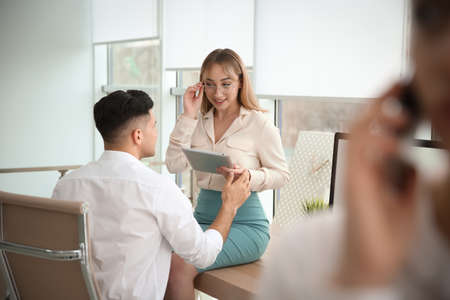 Colleagues flirting with each other during work in office
