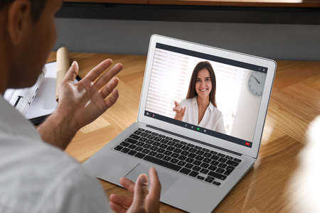 Human resources manager conducting online job interview via video chat Imagens