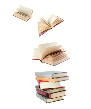 Stacked and flying books on white background, collage Imagens